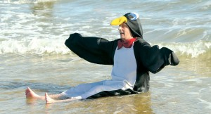 Andrew Foxwell of Ocean City (the penguin for nine years) at the 21st annual AGH Penguin Swim Thursday, January 1, 2105. (Photo by Kristin Roberts)
