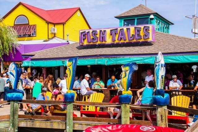 Qualify now for fish tales july 4 hot dog eating event for Fish tales restaurant