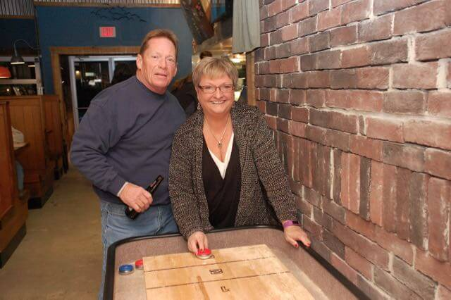 couple playing shuffleboard