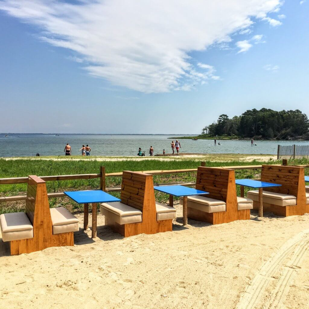 beach seating at the sandy dollar bar and grill